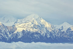 Rolling clouds and frozen mountain summits landscape Royalty Free Stock Photos