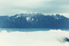 Rolling clouds and frozen mountain summits landscape Royalty Free Stock Photography
