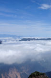 Rolling clouds and mountain summits andscape. Beautiful rolling clouds and mountain summits andscape Stock Image