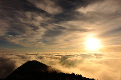 Rolling clouds and sunrise on mountain summits landscape Stock Photography