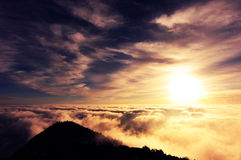 Rolling clouds and sunrise on mountain summits landscape Royalty Free Stock Photos