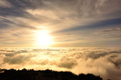 Rolling clouds and sunrise on mountain summits landscape. Beautiful rolling clouds and sunrise on mountain summits landscape Royalty Free Stock Photography
