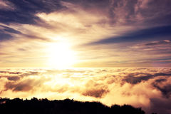 Rolling clouds and sunrise on mountain summits landscape Stock Images