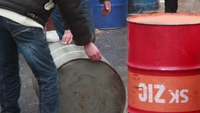 Rolling color barrels with flammable liquid, dangerous usage. Stock footage stock footage