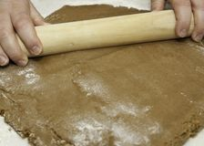 Rolling cookie dough Royalty Free Stock Photo