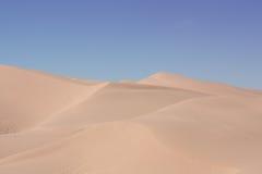 Rolling desert sand dunes Stock Images