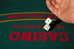 Rolling The Dice. At a casino craps table stock image
