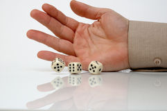 Rolling dice. Conceptual photo, white background Royalty Free Stock Photography