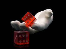 Rolling the Dice. Photo of a hand rolling dice isolated on a black background Stock Images