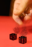 Rolling The Dice. Hand rolling the dice Artistic multiple exposure image showing motion in action Royalty Free Stock Photos