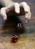 Rolling Dice. A hand rolling a pair of dice Royalty Free Stock Photo