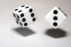 Rolling Dice. Dice in the process of being rolled, fall toward the ground Stock Photography