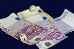 Rolling dice on five-hundred Euro banknotes Stock Photography