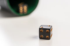 Rolling dice. Green table game Royalty Free Stock Image