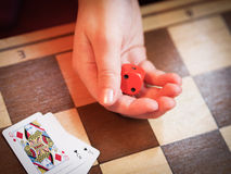 Rolling the Dice. A Hand Rolling a Dice Royalty Free Stock Photo