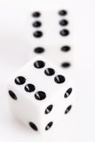 Rolling dice. Over a white background Royalty Free Stock Photography