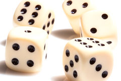 Rolling dice on white tabletop. Rolling dice provide random results . Everyone hopes they are blessed with luck Royalty Free Stock Photo