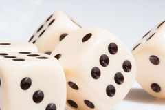 Rolling dice on white tabletop. Rolling dice provide random results . Everyone hopes they are blessed with luck Stock Photo