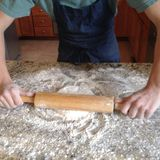 Rolling Dough. A picture of dough being rolled in a kitchen Stock Image