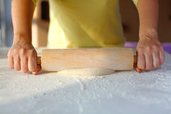 Rolling dough of white flour for pizza Royalty Free Stock Images
