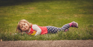 Rolling down on the grass Royalty Free Stock Photo