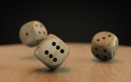 Rolling down three dice Royalty Free Stock Image