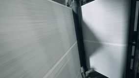 Rolling equipment moves paper, bottom view. stock video