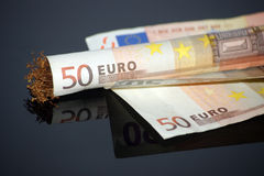 Rolling 50 euro. Tobbaco and money rolling pappers stock photos