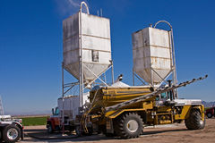 Rolling Fertilizer. Sprayer being filled with fertilizer at plant in Arizona Royalty Free Stock Image