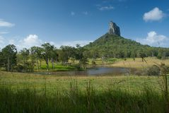 Rolling fields overlooked by Mt Coonowrin, Glasshouse Mountains stock photography