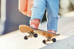 Rolling on the fingerboard in the city. Closeup Stock Photography