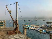Rolling Fog over a Harbor in coastal Maine royalty free stock photography