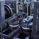 Rolling forming rolls metal works on manufacture of pipes. Rolling mill machine for rolling steel sheet Stock Photography