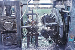 Rolling forming rolls metal works on manufacture of pipes. Rolling mill machine for rolling steel sheet Stock Image