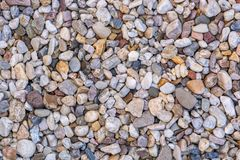 Rolling gravel as a building material for road construction and pond construction stock photography