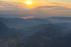 Rolling green hills and lake Bodensee, Switzerland. Aerial view on rolling green hills and in sunset mist with lake Bodensee in the distance, Switzerland Stock Photos