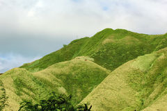 Rolling Green Mountains. A picture of rolling green hills with a cross at the top of the mountain stock image