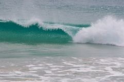 Rolling green surf wave breaking Stock Photo