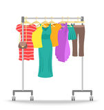 Rolling hanger rack with women clothes collection Royalty Free Stock Images