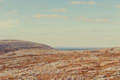 The rolling hills of Burren and Atlantic Ocean Royalty Free Stock Image