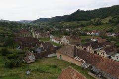 Copsa Mare, Transylvania, Romania. Old Saxon village of Copsa Mare in the rolling hillside of Transylvania, Romania Stock Images