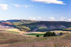 The rolling hills and fertile valleys of the Dargle, Kwazulu-natal, South Africa. The rolling hills and fertile valleys of the Dargle on a fresh winter afternoon stock photo