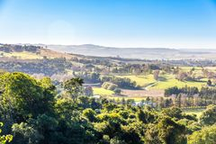 The rolling hills and fertile valleys of the Dargle, Kwazulu-natal, South Africa. The rolling hills and fertile valleys of the Dargle on a fresh winter morning royalty free stock photography