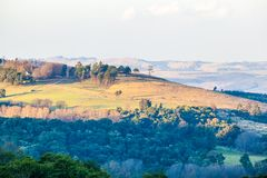 The rolling hills and fertile valleys of the Dargle, Kwazulu-natal, South Africa. The rolling hills and fertile valleys of the Dargle on a fresh winter morning stock photo