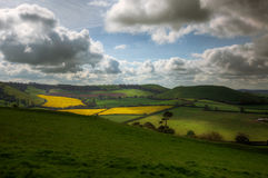 Rolling Hills and Fields in Somerset. View of Rural Landscape from the Top of Cadbury Castle in Somerset, England, UK stock photography