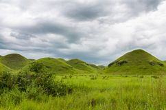 Free Rolling Hills, Lush Green Grass And Soft White Clouds In Countryside Of Republic Of Congo, Central Africa Stock Photography - 117510272