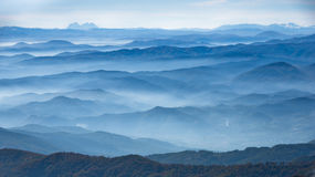 Rolling hills and mountains at autumn sunny day with fog, view from Zeljin mountain Stock Photos
