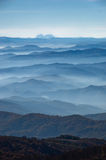 Rolling hills and mountains at autumn sunny day with fog, view from Zeljin mountain Stock Photography
