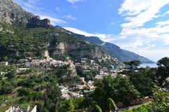 Rolling Hills and Sea Cliffs Surrounding the Village of Positano Stock Photos