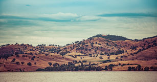 Rolling hills on the shores of Hume Lake, Australia Stock Image
